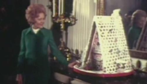 Patricia Nixon and gingerbread house (circa 1970)